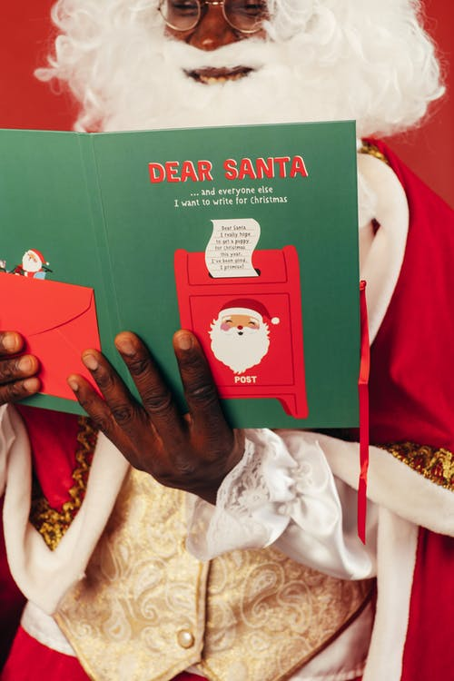 Santa Claus Reading a Christmas Card