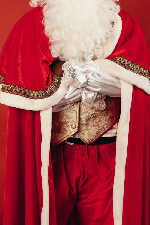 Person Wearing Santa Claus Outfit
