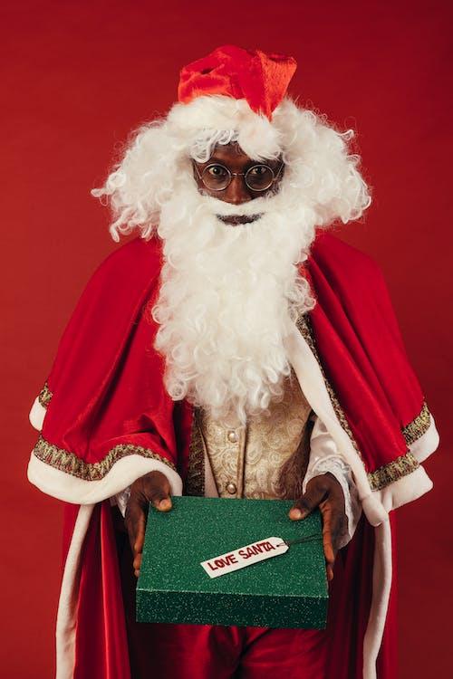 Santa Claus Holding Green Christmas Present