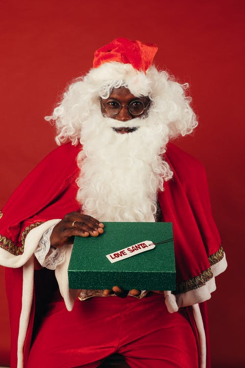 Santa Claus Holding Green Christmas Present