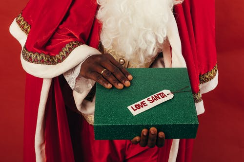 Person Holding Green Christmas Present