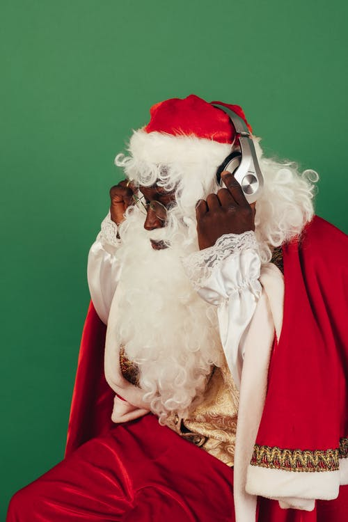 Santa Claus Listening to a Music