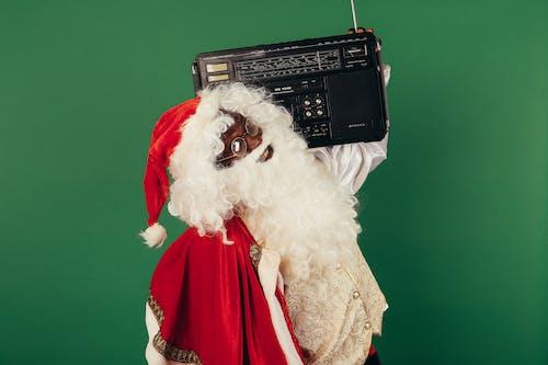 Santa Claus Holding A Classic Radio