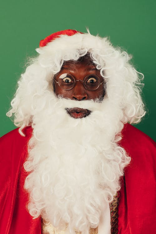 Surprised Man In Santa Outfit