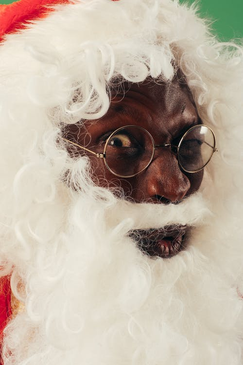 Headshot Of A Man Wearing Santa Outfit