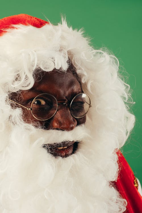 Close-up View Of Man's Face In Santa Outfit