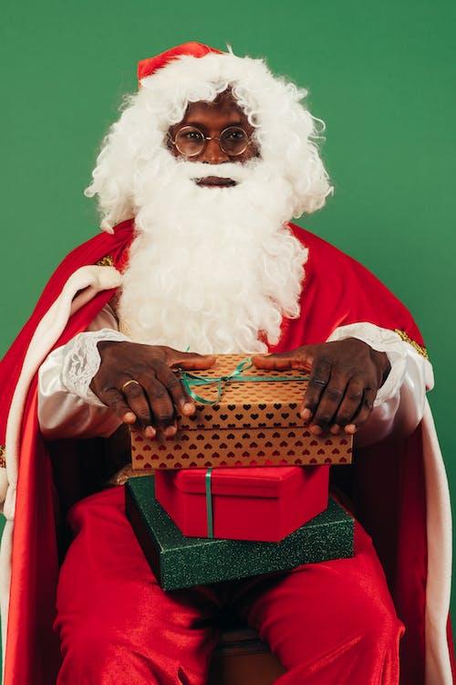 Santa Claus Holding Christmas Presents