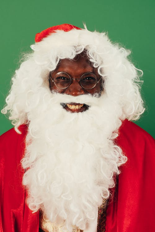 Portrait Of A Smiling Man In Santa Claus Outfit
