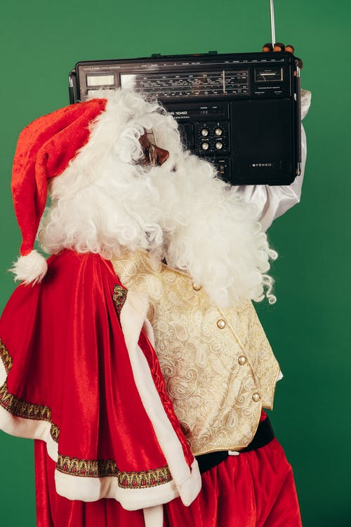Man In Santa Outfit With A Classis Radio