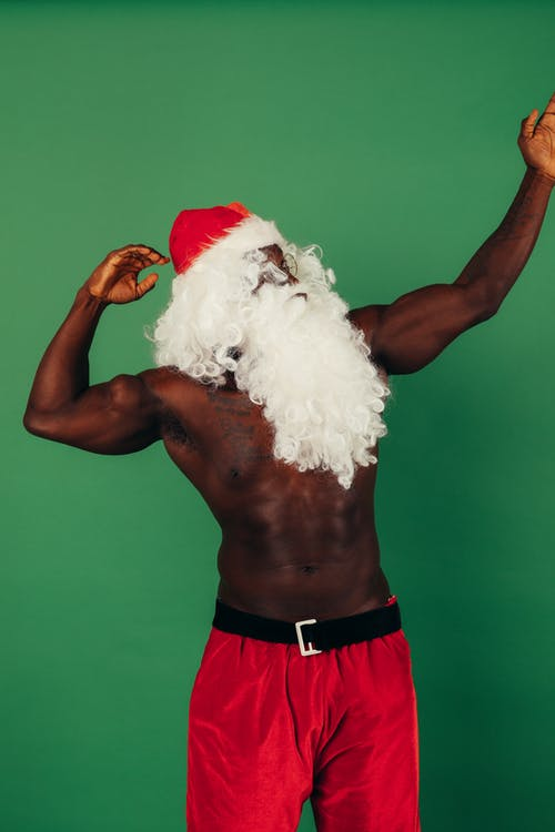 Topless Man With Santa Outfit Flexing His Muscles