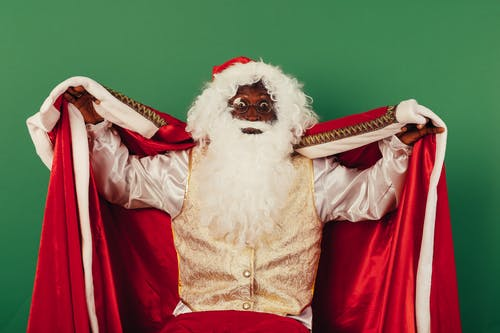 Santa Claus Holding A Red Cloak