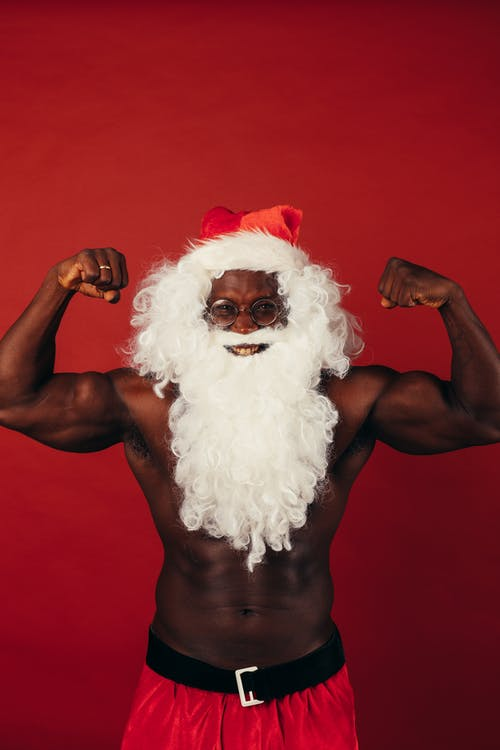 Man In Santa Outfit Flexing His Muscles