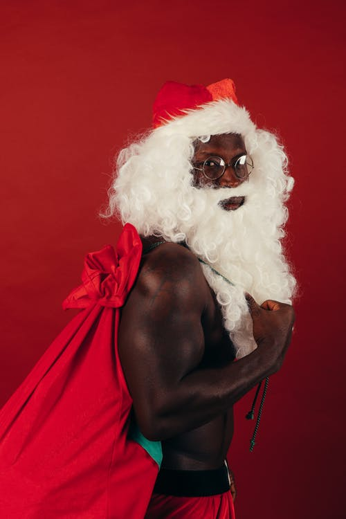 Side View Of Shirtless Man In Santa Outfit
