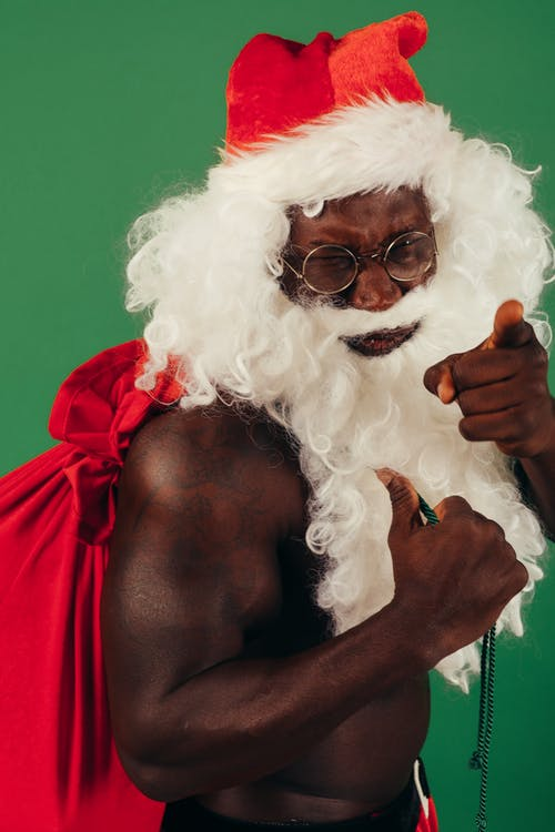 Shirtless Man In Santa Claus Costume