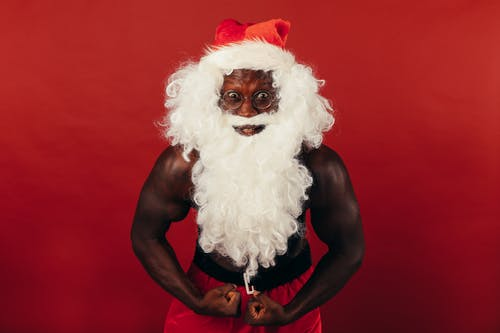 Black Man With Muscular Body Wearing A Santa Costume