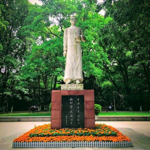 Gray Concrete Statue Near Green Trees