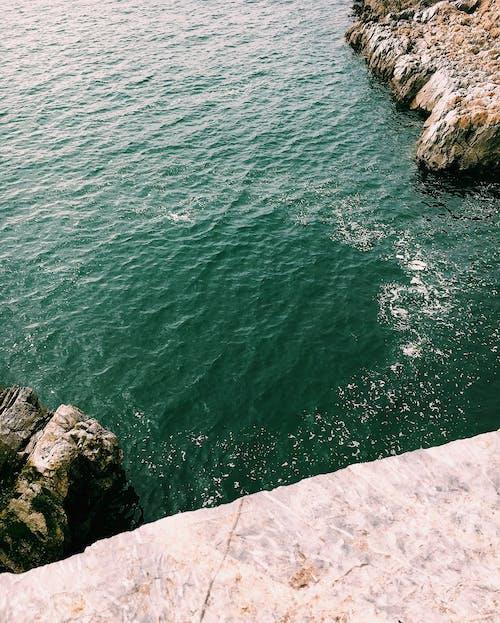 Rocky formations on coast near sea