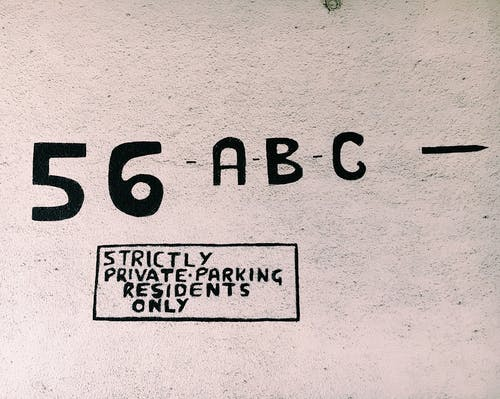 Surface with numbers and letters for private parking