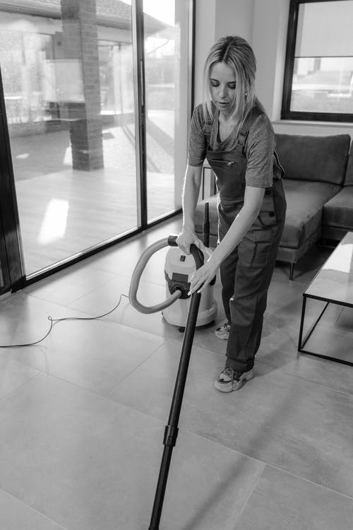 A Woman Cleaning Inside a House