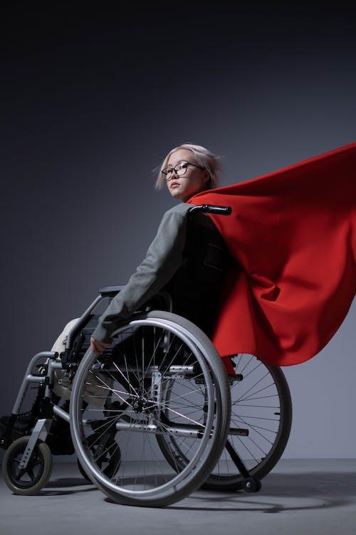 Woman in Black Blazer Sitting on Wheelchair