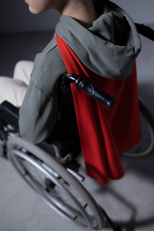 Black and Red Backpack on Black and Gray Wheelchair