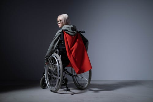 Woman in Black Jacket Sitting on Black Wheelchair