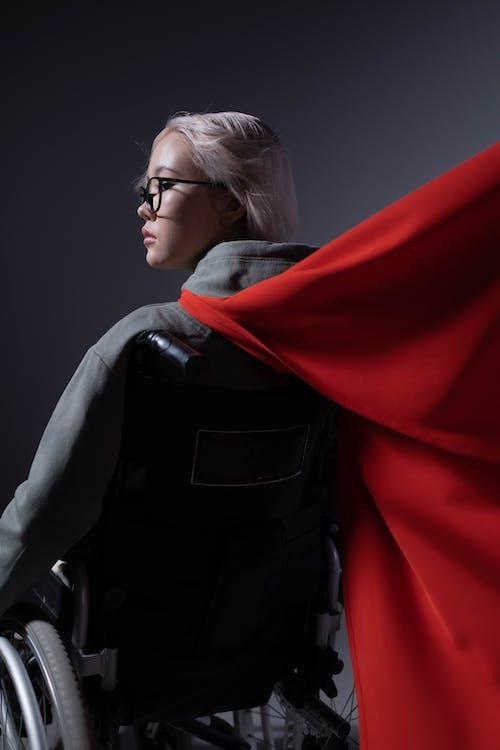 Woman in Black Leather Jacket Wearing Eyeglasses