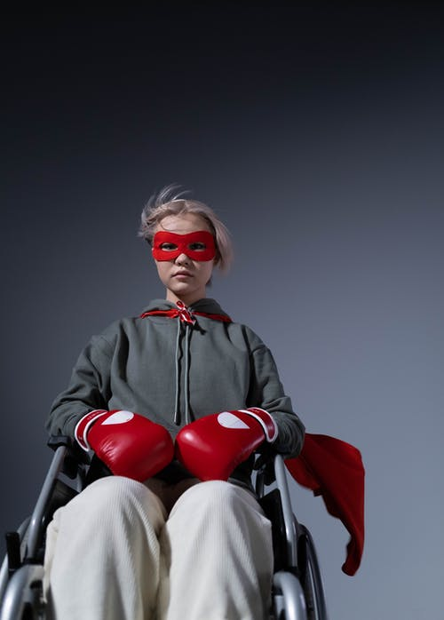 Woman in Black Jacket Wearing Red Sunglasses Sitting on Chair