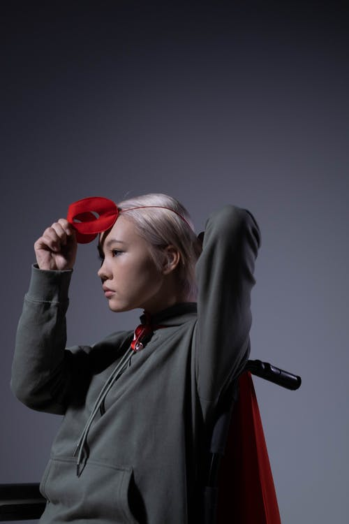 Woman in Gray Jacket Wearing Red Headphones