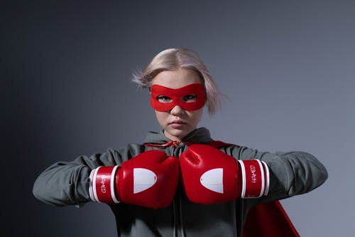 Woman in Red Mask and Black Long Sleeve Shirt