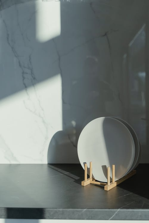 White Round Plate on Table