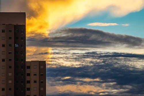 Residential house against cloudy sky
