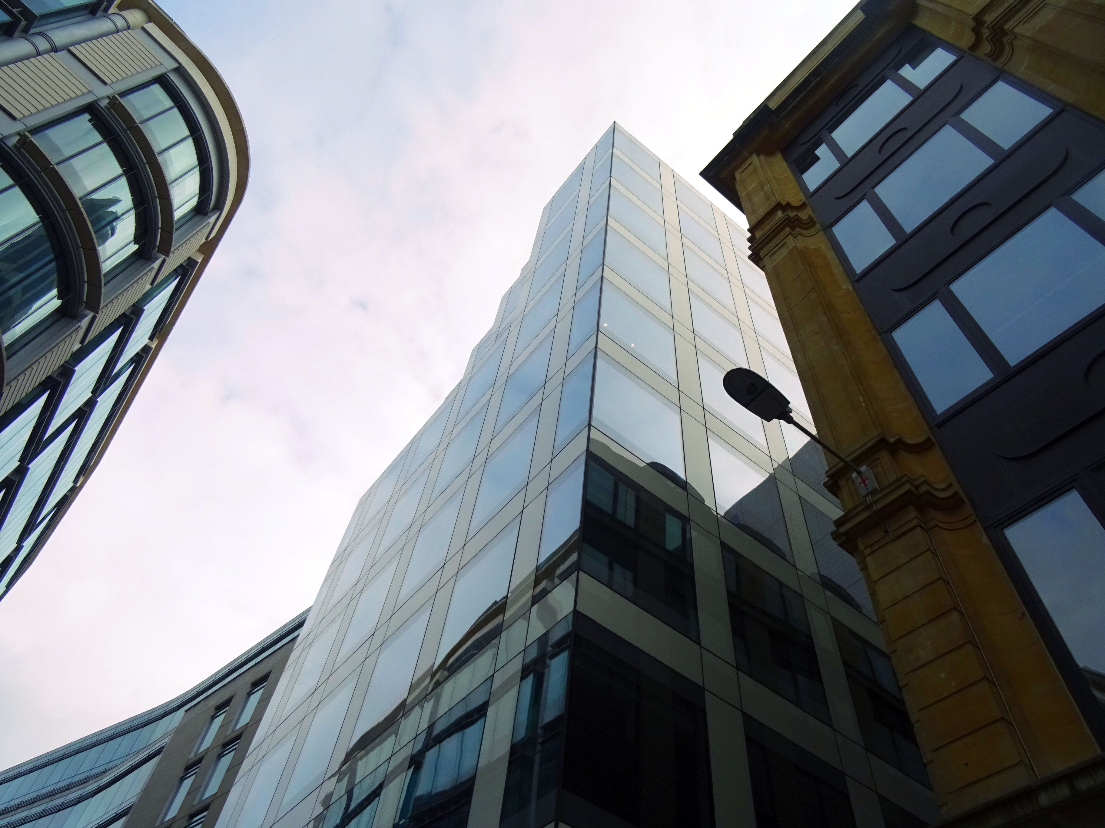 Low-angle Photography of Glass Building during Day