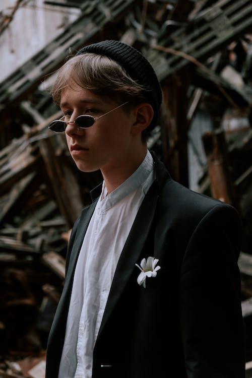 Woman in Black Suit Wearing Sunglasses