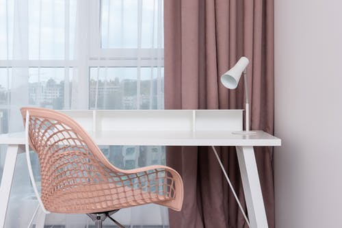 Simple workspace in light modern apartment