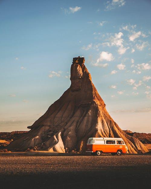 White Van Near Brown Rock Formation