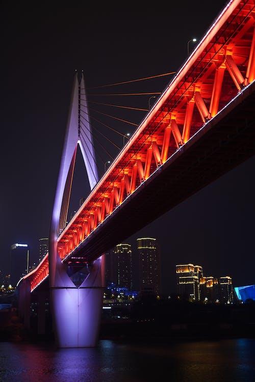 White Bridge over City during Night Time