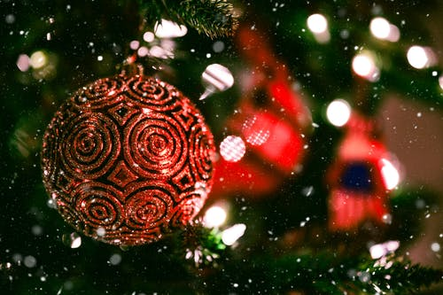 Xmas decorations hanging on fir tree during festive event