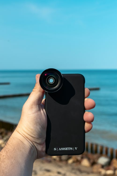 Close-Up Shot of a Person Holding a Smartphone
