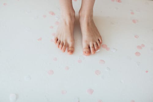 Persons Feet on Pink Surface