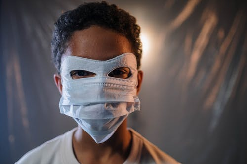Boy in White Face Mask