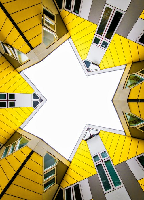 White Blue and Yellow Concrete Building