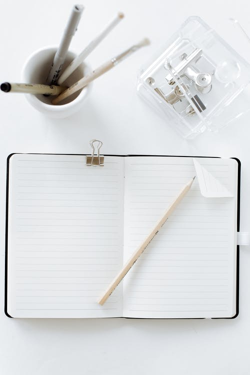 White Notebook and White Pencil