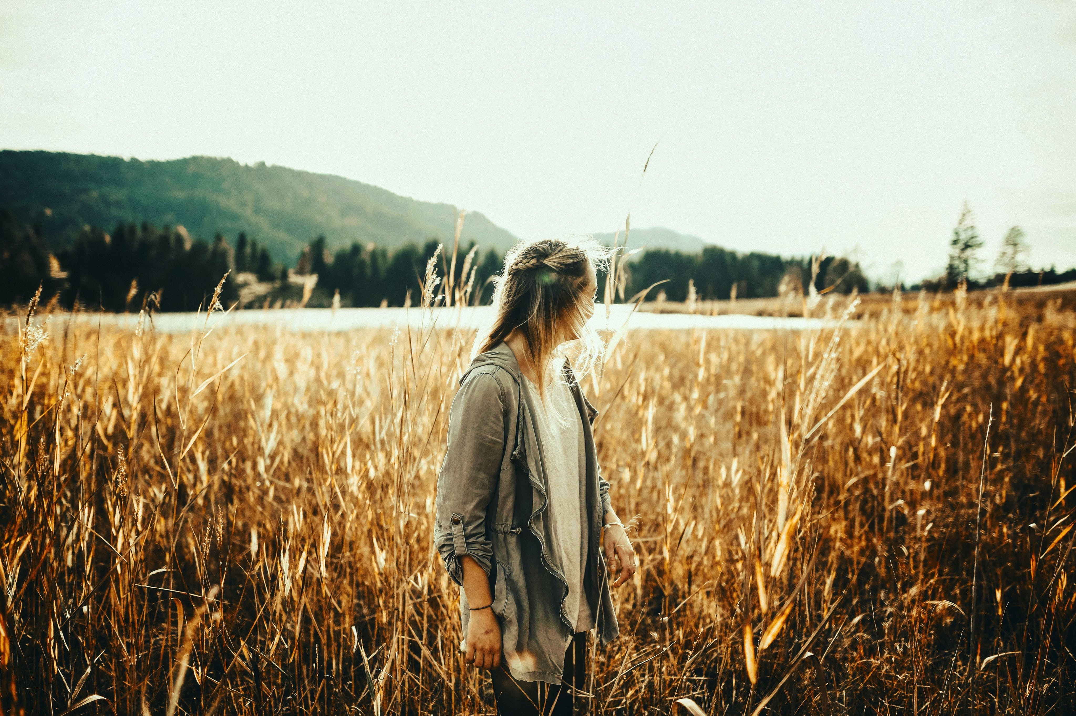 Woman Standing in the Middle of Plant Field
