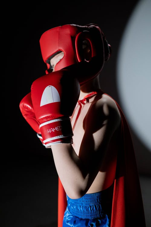 Woman in Red Boxing Gloves