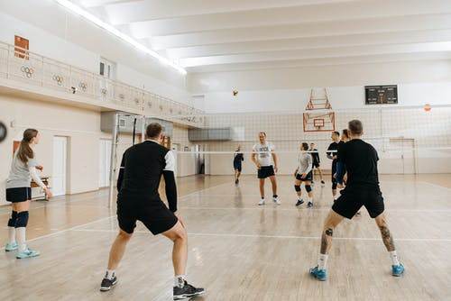 People Standing on the Volleyball Court Waiting for the Ball