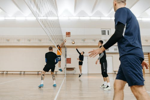 Men in Sports Wear Playing Volleyball
