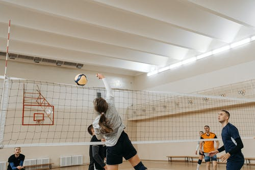 Athletic People Playing Volleyball