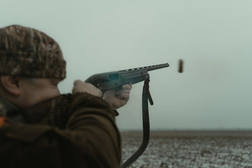 A Man Shooting on a Moving Target