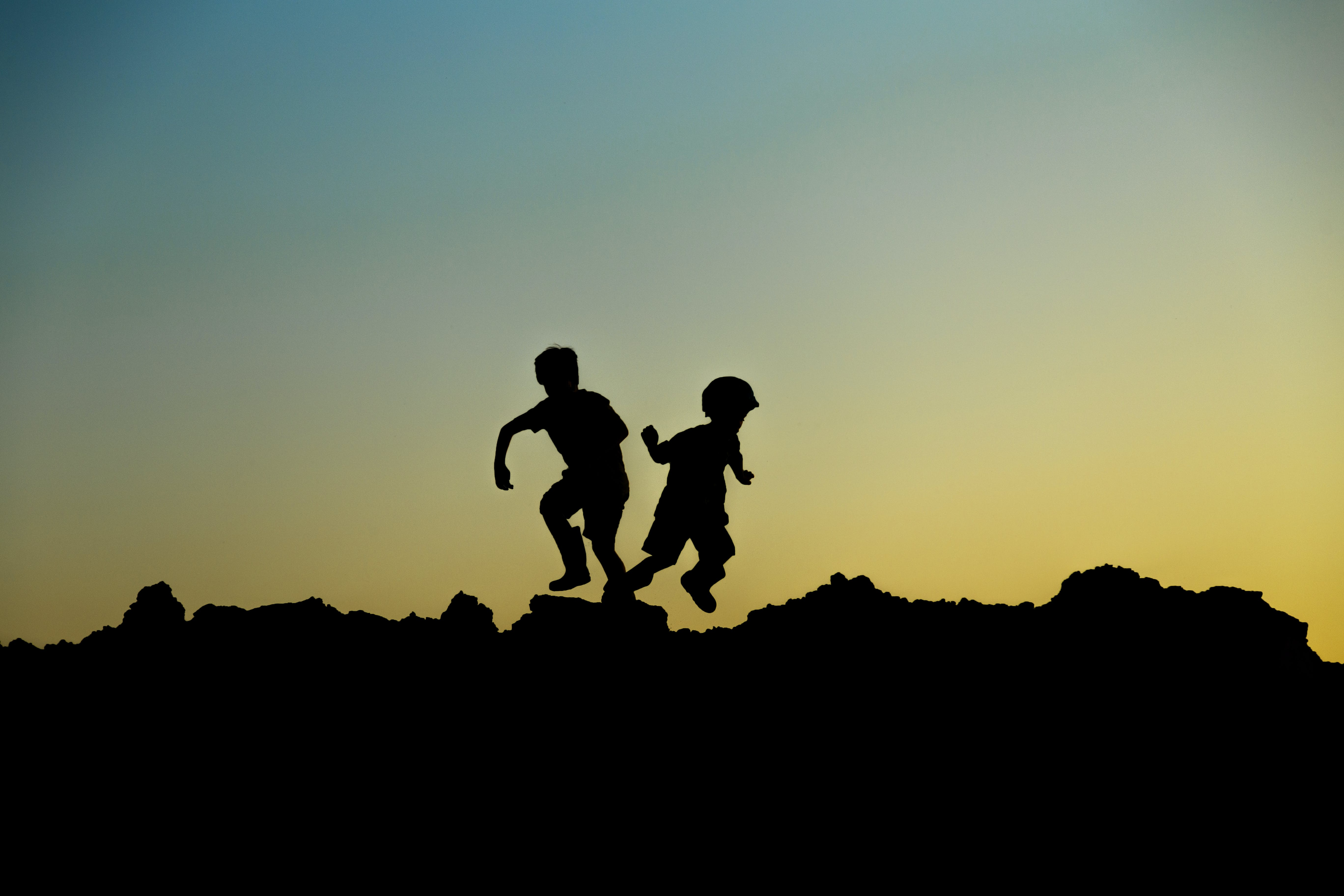 Silhouette Photo of Jumping Children